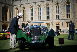 © London News Pictures. 07/09/2012. Windsor, UK . A  car owner examining his 1937 Lagonda LG45 Rapide Tourer, one of 60 of the rarest motorcars from around the world at Windsor Castle in Berkshire for the WIndsor Castle Concours Of Elegance on September 07, 2012. The three day event is open to the public on Saturday and Sunday. Photo credit: Ben Cawthra/LNP