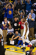 Golden State Warriors forward Kevin Durant (35) celebrates with fans after scoring a basket against the Houston Rockets at Oracle Arena in Oakland, Calif., on December 1, 2016. (Stan Olszewski/Special to S.F. Examiner)