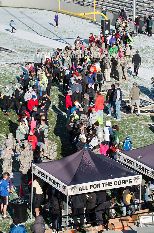 West Point, New York - Runners line up on the football field at Michie Stadium to sign in for the West Point Half-Marathon Fallen Comrades Run at the United States Military Academy on March 29, 2015.