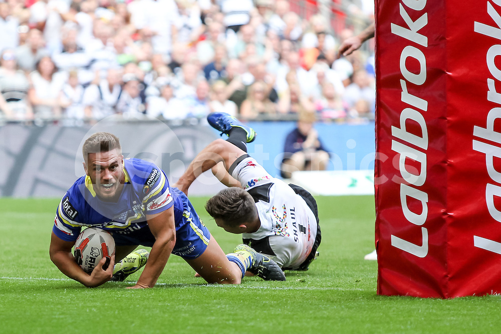 Chris Hill, captain of Warrington Wolves scores the opening try to make it 4-0 during the Ladbrokes Challenge Cup Final match between Hull FC and Warrington Wolves at Wembley Stadium, London, England on 27 August 2016. Photo by Ken Sparks.