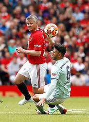Manchester United Legends Ole Gunnar Solskjaer (left) and Bayern Munich Legends Martin Demichelis battle for the ball during the legends match at Old Trafford, Manchester.