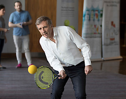 LIVERPOOL, ENGLAND - Thursday, April 19, 2018: Former Liverpool player Alan Kennedy plays tennis before a press event at the Hilton Hotel for the launch of the 2018 Liverpool International Tennis Tournament, which will be held at Liverpool Cricket Club 21st to 24th June. (Pic by Jason Roberts/Propaganda)