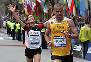 (041910  Boston, MA)  Michael Arnstein, 33, of NY,  crosses the finish line of the 2010 Boston Marathon in under 2.5 hours, a goal he has been trying to reach for 15 years.  Michael immediately went to the crowd and borrowed a cell phone from Karen Richter, of Rugby, North Dakota, to call his wife.