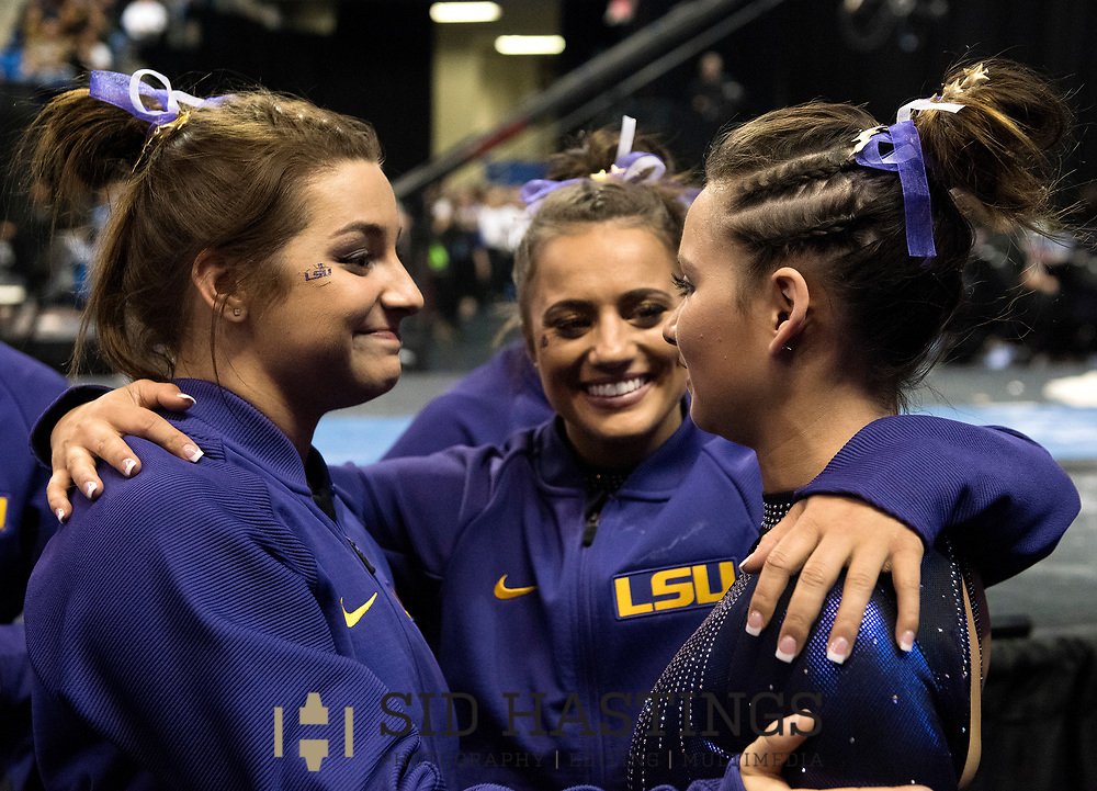 21 APRIL 2018 -- ST. LOUIS -- LSU gymnasts McKenna Kelley (left), Lexie Priessman and Sarah Finnegan console one other after as final scores are tallied during the 2018 NCAA Women's Gymnastics Championship Super Six at Chaifetz Arena in St. Louis Saturday, April 21, 2018. The Tigers finished fourth in the nation during the meet.<br /> Photo &copy; copyright 2018 Sid Hastings.