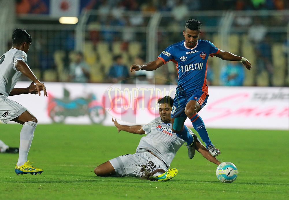Mandarrao Dattarao Dessai of FC Goa and Rahul Bheke of FC Pune City in action  during match 8 of the Indian Super League (ISL) season 3 between FC Goa and FC Pune City held at the Fatorda Stadium in Goa, India on the 8th October 2016.<br /> <br /> Photo by Vipin Pawar / ISL/ SPORTZPICS