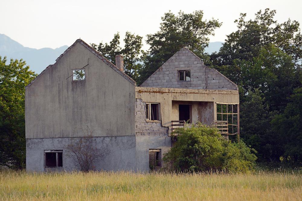 Abandoned houses from the Balkan war 1991-1995, outside Velebit Nature Park, Rewilding Europe rewilding area, Velebit  mountains, Croatia
