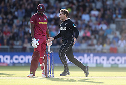 New Zealand's Lockie Ferguson celebrates taking the wicket of West Indies Jason Holder during the ICC Cricket World Cup group stage match at Old Trafford, Manchester.