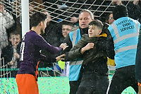 Football - 2018 / 2019 Emirates FA Cup - Quarter-Final: Swansea City vs. Manchester City<br /> <br /> A young rich invader is held by stewards close to a Man City player, at The Liberty Stadium.<br /> <br /> COLORSPORT/WINSTON BYNORTH