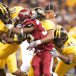 21 December 2008:  Southern Miss defenders tackle Troy running back DuJuan Harris (32) during a 30-27 overtime victory by the Southern Mississippi Golden Eagles over the Troy Trojans in the  R+L Carriers New Orleans Bowl at the New Orleans Superdome in New Orleans, LA.