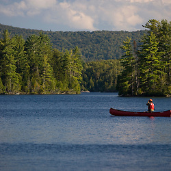 Canoeing on Prong Pond near Moosehead Lake in Maine USA