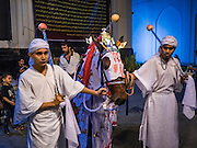 23 OCTOBER 2015 - YANGON, MYANMAR: Shia men with a horse to reenact the death of Hussein ibn Ali during Ashura observances at Mogul Mosque in Yangon. Ashura commemorates the death of Hussein ibn Ali, the grandson of the Prophet Muhammed, in the 7th century. Hussein ibn Ali is considered by Shia Muslims to be the third imam and the rightful successor of Muhammed. He was killed at the Battle of Karbala in 610 CE on the 10th day of Muharram, the first month of the Islamic calendar. According to Myanmar government statistics, only about 4% of the population is Muslim. Many Muslims have fled Myanmar in recent years because of violence directed against Burmese Muslims by Buddhist nationalists.  PHOTO BY JACK KURTZ