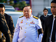 03 NOVEMBER 2018 - BANGKOK, THAILAND:  Gen. PRAWIT WONGSUWAN, Deputy Prime Minister of Thailand, arrives at Wat Debsirin on the first day of funeral rites for Vichai Srivaddhanaprabha. Vichai was the owner of King Power, a Thai duty free conglomerate, and the Leicester City Club, a British Premier League football (soccer) team. He died in a helicopter crash in the parking lot of the King Power stadium in Leicester after a match on October 27. Vichai was Thailand's 5th richest man. The funeral is expected to last one week.   PHOTO BY JACK KURTZ