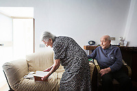 ACCIAROLI (POLLICA), ITALY - 5 OCTOBER 2016: (L-R) 93-years-old Amina Fedullo leafs through the pages of her own poetry as her 100-years-old husband Antonio Vassallo looks at her in their home in Acciaroli, a hamlet in the municipality of Pollica, Italy, on October 5th 2016. Mrs Fedullo was a farmer her entire life, while Mr Vassallo was a soldier in Italy's military forces in the Italian East Africa, the Italian colony in the Horn of Africa. They've been married for 66 years.<br /> <br /> To understand how people can live longer throughout the world, researchers at University of California, San Diego School of Medicine have teamed up with colleagues at University of Rome La Sapienza to study a group of 300 citizens, all over 100 years old, living in Acciaroli (Pollica), a remote Italian village nestled between the ocean and mountains in Cilento, southern Italy.<br /> <br /> About 1-in-60 of the area's inhabitants are older than 90, according to the researchers. Such a concentration rivals that of other so-called blue zones, like Sardinia and Okinawa, which have unusually large percentages of very old people. In the 2010 census, about 1-in-163 Americans were 90 or older.