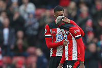Football - 2019 / 2020 Premier League - Southampton vs. Newcastle United<br /> <br /> Southampton's Moussa Djenepo covers his face as he leaves the field of play after receiving a red card during the Premier League match at St Mary's Stadium Southampton <br /> <br /> COLORSPORT/SHAUN BOGGUST