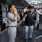 NEW YORK, NEW YORK - June 14:  John Jaso #28 of the Pittsburgh Pirates in the dugout preparing to bat during the Pittsburgh Pirates Vs New York Mets regular season MLB game at Citi Field on June 14, 2016 in New York City. (Photo by Tim Clayton/Corbis via Getty Images)