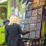 Couple shopping for alternative jewellery on Camden High Street, London,