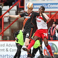Picture by David Horn/Focus Images Ltd +44 7545 970036.16/03/2013.Bondz N'gala of Stevenage (right) and Dave Kitson of Sheffield Utd (left) during the npower League 1 match at the Lamex Stadium, Stevenage.
