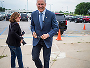 03 JUNE 2019 - ANKENY, IOWA: Governor JAY INSLEE, (D-WA), walks into DMACC Monday. Governor Inslee is running to be the Democratic candidate for the US Presidency in 2020, He has made climate change a central point of his campaign and he toured a wind turbine program at the Des Moines Area Community College (DMACC) in Ankeny. Iowa generates more than 35% of its electrical needs through wind power. Iowa traditionally hosts the the first election event of the presidential election cycle. The Iowa Caucuses will be on Feb. 3, 2020.                        PHOTO BY JACK KURTZ