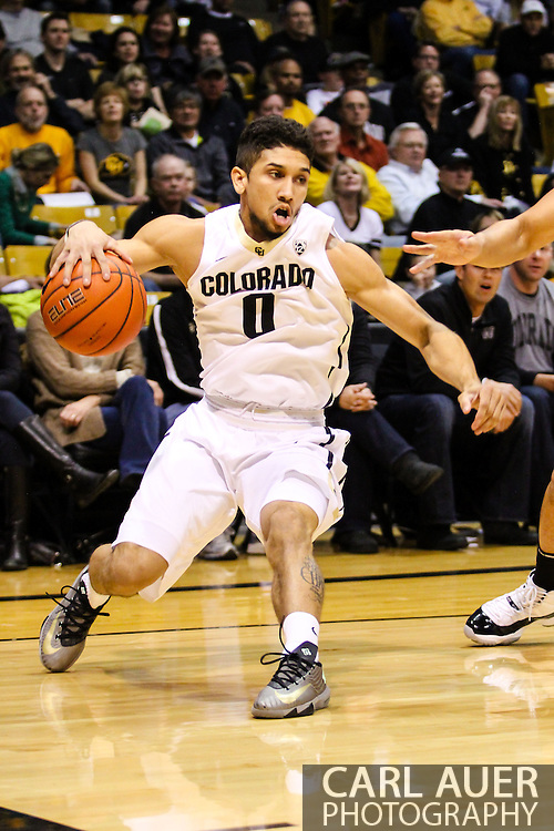 February 9th, 2014:  Colorado Buffaloes junior guard Askia Booker (0) fakes a move baseline in the first half of the NCAA Basketball game between the Washington Huskies and the University of Colorado Buffaloes at the Coors Events Center in Boulder, Colorado