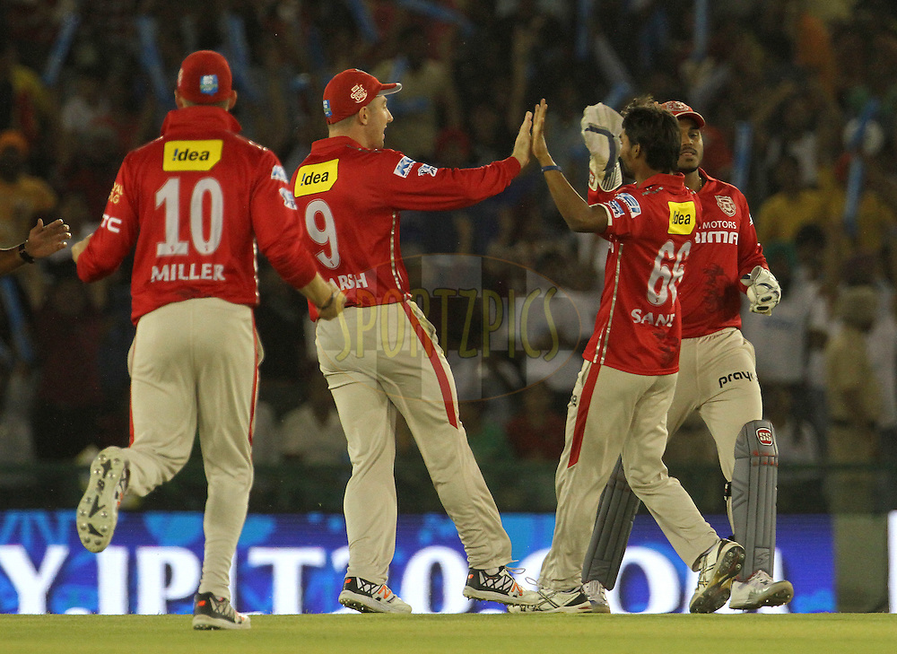 Kings XI Punjab players celebrates the wicket of Mumbai Indians captain Rohit Sharma during match 21 of the Vivo Indian Premier League ( IPL ) 2016 between the Kings XI Punjab and the Mumbai Indians held at the IS Bindra Stadium, Mohali, India on the 25th April 2016<br /> <br /> Photo by Vipin Pawar / IPL/ SPORTZPICS