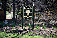 9 April, 2009. Brookville, NY. A welcome sign is here at the entrance of Brookville, NY, on Cedar Swamp Road. The Gold Coast village of Brookville is the wealthiest community in the United States, according to a survey published Wednesday by BusinessWeek magazine.<br /> <br /> Brookville was one of nine Long Island communities to make the magazine's list of the country's 25 wealthiest towns, based on research by the Gadberry Group, of Little Rock, Ark.<br /> <br /> The village's mayor, Caroline Zimmermann Bazzini, said Brookville residents likely felt the pain of recession much less than most other folks.<br /> <br /> Brookville residents had the highest average net worth of any town on the list: $1.67 million. The enclave's well-to-do denizens had an average annual income of $328,000, ranking it seventh on the list.<br /> <br /> ©2009 Gianni Cipriano<br /> cell. +1 646 465 2168 (USA)<br /> cell. +1 328 567 7923 (Italy)<br /> gianni@giannicipriano.com<br /> www.giannicipriano.com
