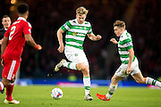 Celtic midfielder Stuart Armstrong (#14) back heels the ball to Celtic midfielder James Forrest (#49) during the Scottish Cup final match between Aberdeen and Celtic at Hampden Park, Glasgow, United Kingdom on 27 November 2016. Photo by Craig Doyle.