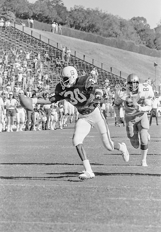 PALO ALTO, CA -  OCTOBER 8:  Wide receiver James Lofton #30 of Stanford University makes a catch during a PAC-8 NCAA football game against the UCLA Bruins played on October 8. 1977 at Stanford Stadium on the campus of Stanford University in Palo Alto, California. Jerry Robinson #84 of UCLA defends.  Lofton later played in the NFL and is a member of the Pro Football Hall of Fame. (Photo by David Madison/Getty Images) *** Local Caption *** James Lofton