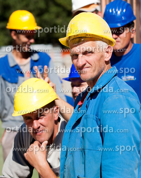 Workers at media day of Slovenian Ski jumping team during construction of two new ski jumping hills HS 135 and HS 105, on September 18, 2012 in Planica, Slovenia. (Photo By Vid Ponikvar / Sportida)