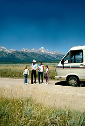 RV Travel Through Wyoming, lifestyle, couple, family vacation, vertical scenic landscape, mountains.Photo copyright Lee Foster, www.fostertravel.com.Photo #: rvstyl104, 510/549-2202, lee@fostertravel.com