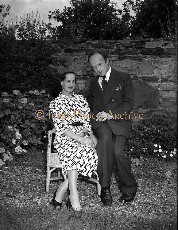 Erskine Childers, minister for Posts and Telegraphs with fiance, Miss Rita Dudley<br /> 22/08/1952<br /> <br /> Erskine Hamilton Childers (11/12/1905 – 17/11/1974) served as the fourth President of Ireland from 1973 until his death in 1974.  He was a TD from 1938 until 1973. He was appointed Tánaiste in 1969.<br />His father Robert Erskine Childers, a leading Irish Republican and author of the espionage thriller The Riddle of the Sands, was executed during the Irish Civil War. <br /><br />Childers married Ruth Ellen Dow in 1925. They had five children, Ruth Ellen Childers, born in July 1927, Erskine, born in March 1929, followed by Roderick Winthrop Childers in June 1931, and in November 1937 twin daughters, Carainn and Margaret Osgood Childers. <br />After the death of Dow in 1950, Childers married again, in 1952, to Rita Dudley. Together they had a daughter, Nessa, who is currently a Labour Party MEP. Childers is survived by children from both his marriages. <br />On 17 November 1974, just after making a speech to the Royal College of Physicians in Dublin, Childers suffered a heart attack. He died the same day at Mater Misericordiae University Hospital. Childers's state funeral in St. Patrick's Cathedral, Dublin, was attended by world leaders.<br /><br />Rita Dudley died on 9 May 2010.