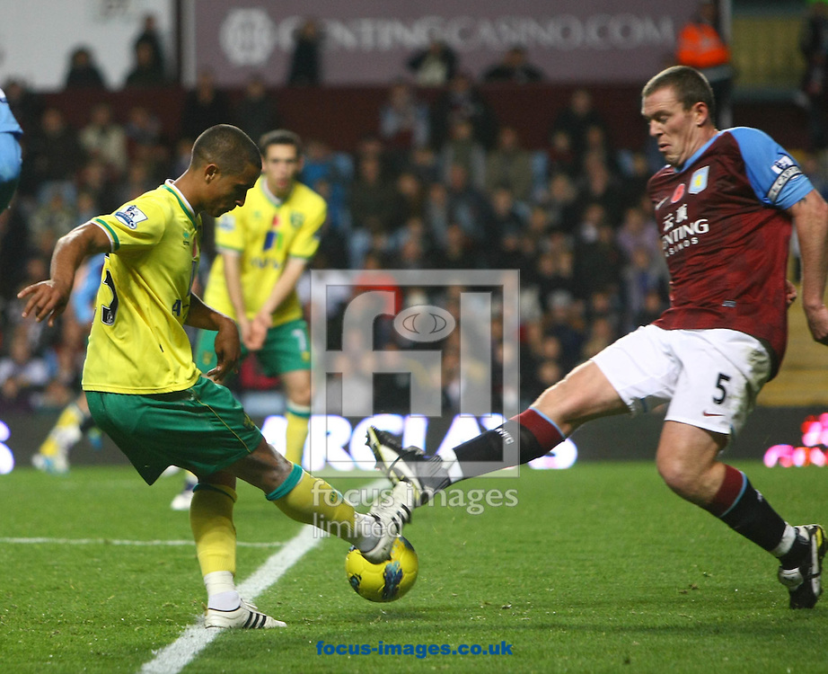 Picture by Paul Chesterton/Focus Images Ltd.  07904 640267.5/11/11 .Kyle Naughton of Norwich and Richard Dunne of Aston Villa in action during the Barclays Premier League match at Villa Park stadium, Birmingham.