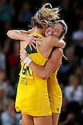 Julie Corletto and Laura Geitz of Australia celebrate after winning the Netball Final between New Zealand and Australia. Glasgow 2014 Commonwealth Games. Netball Final, Silver Ferns v Diamonds, The Hydro, Glasgow, Scotland. Sunday 3 August 2014. Photo: Anthony Au-Yeung / photosport.co.nz