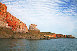 Stunning rock formations near The Sisters in Yampi Sound.  The distinctive tide line seen around the Kimberley coast is visible at low tide, as are small rocky formations that form small islands at high tide, or are completely submerged.