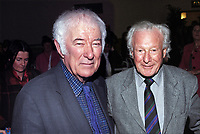 Nobel Laureate poet Seamus Heaney, left, meets Irish rugby legend Jack Kyle, a member of the winning Irish team in 1948 Five Nations Championship. The occasion was a lunch at Queen's University Belfast, followed by Heaney being interviewed by local Belfast broadcaster William Crawley. The Heaney interview was one in a series with politicians, academics, authors, historians, etc.  200912023174.<br /> <br /> Copyright Image from Victor Patterson,<br /> 54 Dorchester Park, <br /> Belfast, UK, BT9 <br /> <br /> t1: +44 28 9066 1296 (from Rep of Ireland 048 90661296)<br /> t2: +44 28 9002 2446 (from Rep of Ireland 048 9002 2446)<br /> <br /> m: +44 7802 353836<br /> <br /> e: victorpatterson@me.com<br /> www.victorpatterson.com<br /> <br /> Please see my Terms and Conditions of Use at www.victorpatterson.com. It is IMPORTANT that you familiarise yourself with them.<br /> <br /> Images used on the Internet must be visibly watermarked i.e. © Victor Patterson<br /> within the body of the image and copyright metadata must not be deleted. Images <br /> used on the Internet have a size restriction of 4kbs and will be chargeable at current<br />  NUJ rates unless agreed otherwise.<br /> <br /> This image is only available for the use of the download recipient i.e. television station, newspaper, magazine, book publisher, etc, and must not be passed on to any third <br /> party. It is also downloaded on condition that each and every usage is notified within 7 days to victorpatterson@me.com<br /> <br /> The right of Victor Patterson to be identified as the author is asserted in accordance with The Copyright Designs And Patents Act (1988). All moral rights are asserted.