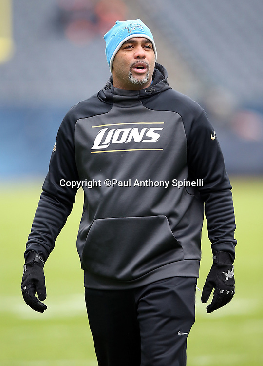 Detroit Lions defensive coordinator Teryl Austin looks on while walking on the field before the NFL week 17 regular season football game against the Chicago Bears on Sunday, Jan. 3, 2016 in Chicago. The Lions won the game 24-20. (©Paul Anthony Spinelli)