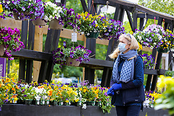 © Licensed to London News Pictures. 14/05/2020. London, UK. A woman wearing a face covering in Capital Gardens in Alexandra Palace, north London after the government eased the COVID-19 lockdown, allowing garden centres to open after seven weeks. Photo credit: Dinendra Haria/LNP