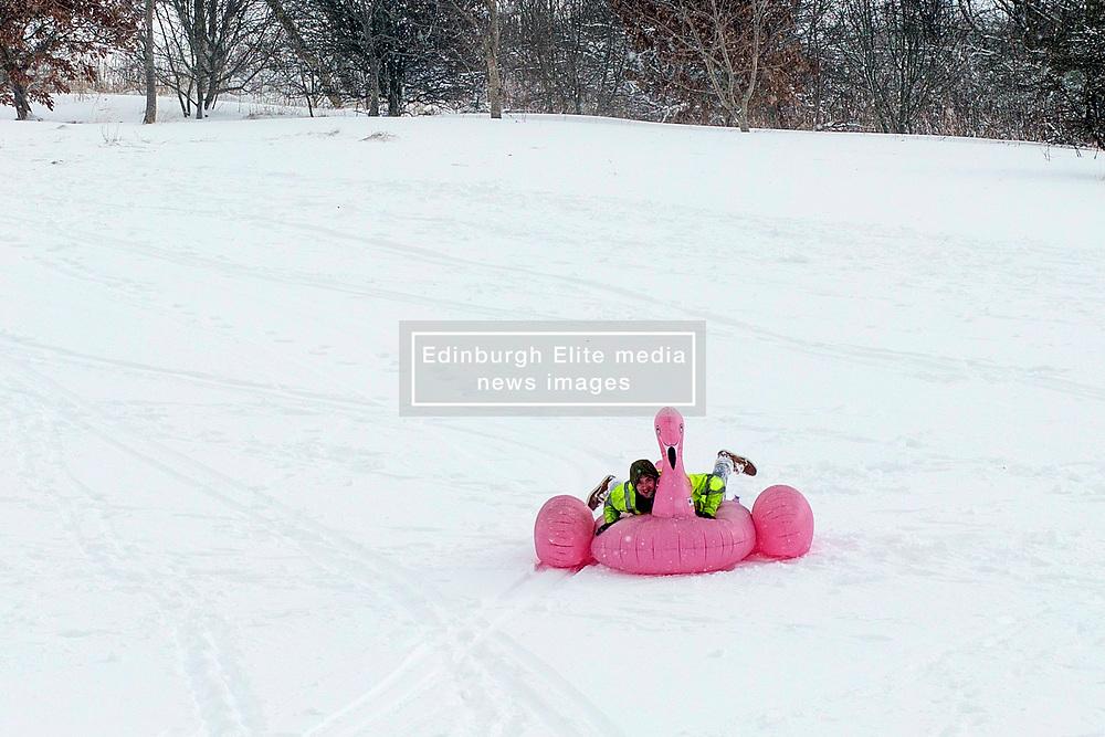The Beast From the East, Dunfermline, 01/03/2018<br />A man enjoys the snow on an inflatable flamingo on Pitreavie golf course, Dunfermline<br />(c)Craig Brown| Edinburgh Elite media