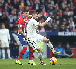 February 9, 2019 - Madrid, Spain - Real Madrid's French forward Karim Benzema (R) challenges Atletico Madrid's Uruguayan defender Jose Gimenez  during the La Liga match between Club Atletico de Madrid and Real Madrid CF at Wanda Metropolitano on February 09, 2019 in Madrid, Spain. (Credit Image: © Raddad Jebarah/NurPhoto via ZUMA Press)