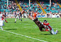 KELOWNA, CANADA - SEPTEMBER 16: Wide receiver Kian Ishani #8 of the Okanagan Sun is tackled by defensive back Isaiah Johns #21 of the Vancouver Island Raiders during the second quarter on September 16, 2018, at the Apple Bowl, in Kelowna, British Columbia, Canada.  (Photo by Marissa Baecker/Shoot the Breeze)  *** Local Caption ***