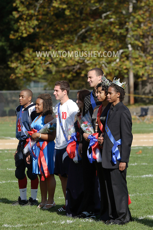 Peekskill, NY - The homecoming king and queen and members of their court stand on the football field at halftime of a game between Poughkeepsie and Peekskill in Peekskill on Oct. 18, 2008.