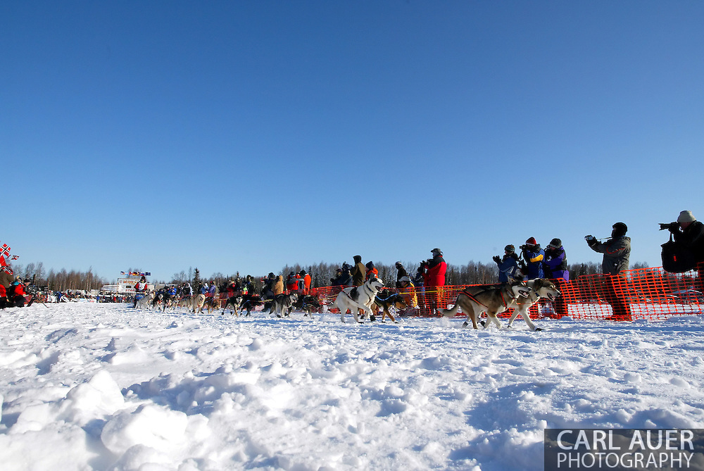 3/4/2007:  Willow, Alaska -  Rookie Sigrid Ekran of Kotzebue, AK flies past the cheering crowds as she heads out at the start of the 35th Iditarod Sled Dog Race