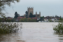 © London News Pictures. 01/05/2012. Tewkesbury, UK. A mass of flood water in front of the town of Tewkesbury, Gloucestershire, England on May 1, 2012. The UK has had its wettest April in over a century, with some areas seeing three times their usual average rainfall, according to figures from the Met Office. Photo credit : Ben Cawthra /LNP
