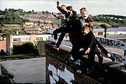 Boys Jumping off Roof, St Hughes Avenue, High Wycombe, UK, 1980s.