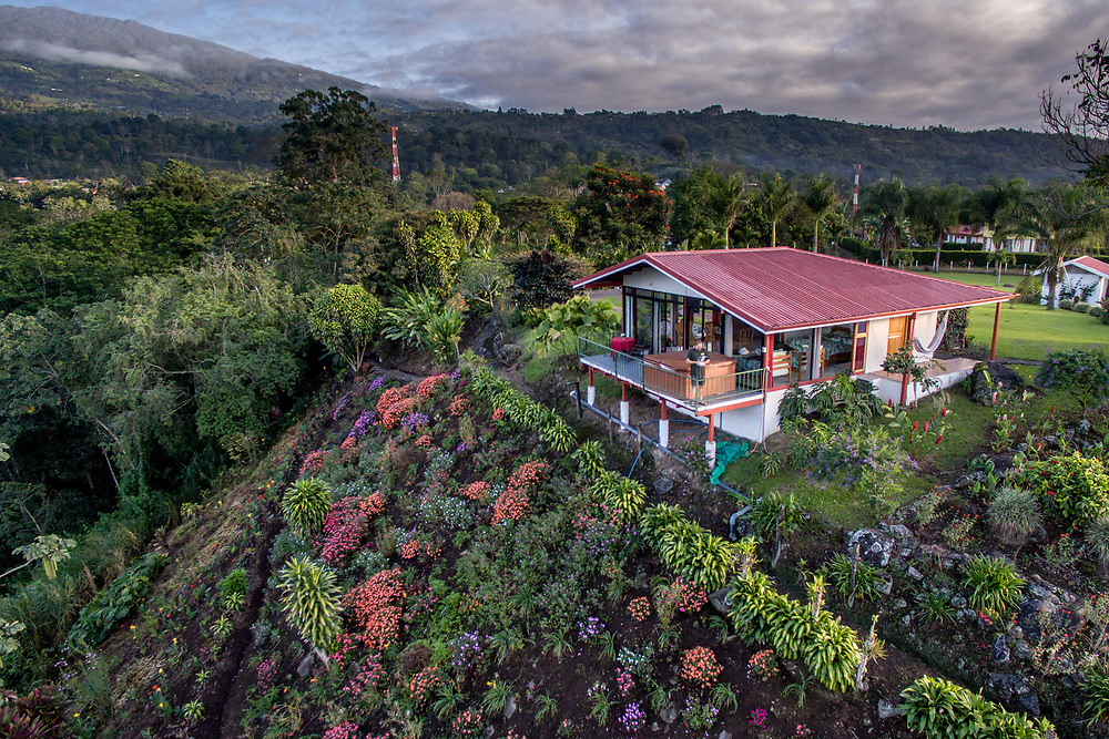 A little home sits upon a lush hillside just outside of the town of Aquires in Costa Rica.