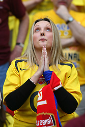 PARIS, FRANCE - WEDNESDAY, MAY 17th, 2006: An Arsenal fan prays during the UEFA Champions League Final against FC Barcelona at the Stade de France. (Pic by David Rawcliffe/Propaganda)