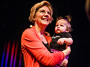 "25 APRIL 2019 - CEDAR RAPIDS, IOWA: US Sen. ELIZABETH WARREN (D MA) holds a baby wearing a tee shirt that says ""Nevertheless she persisted"" after Warren's campaign speech at the Linn Phoenix Club in Cedar Rapids. Warren's supporters adapted ""Nevertheless she persisted"" as their own after Mitch McConnell said it to Warren as an insult. The Linn Phoenix Club is an organization that promotes Democratic candidates in Linn County, Iowa. Sen. Warren is campaigning in eastern Iowa Thursday night and Friday to promote her bid to the Democratic candidate for the US Presidency. Iowa traditionally hosts the the first selection event of the presidential election cycle. The Iowa Caucuses will be on Feb. 3, 2020.            PHOTO BY JACK KURTZ"