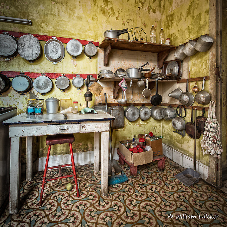 Kitchen pots and pans displayed in an old Havana home.