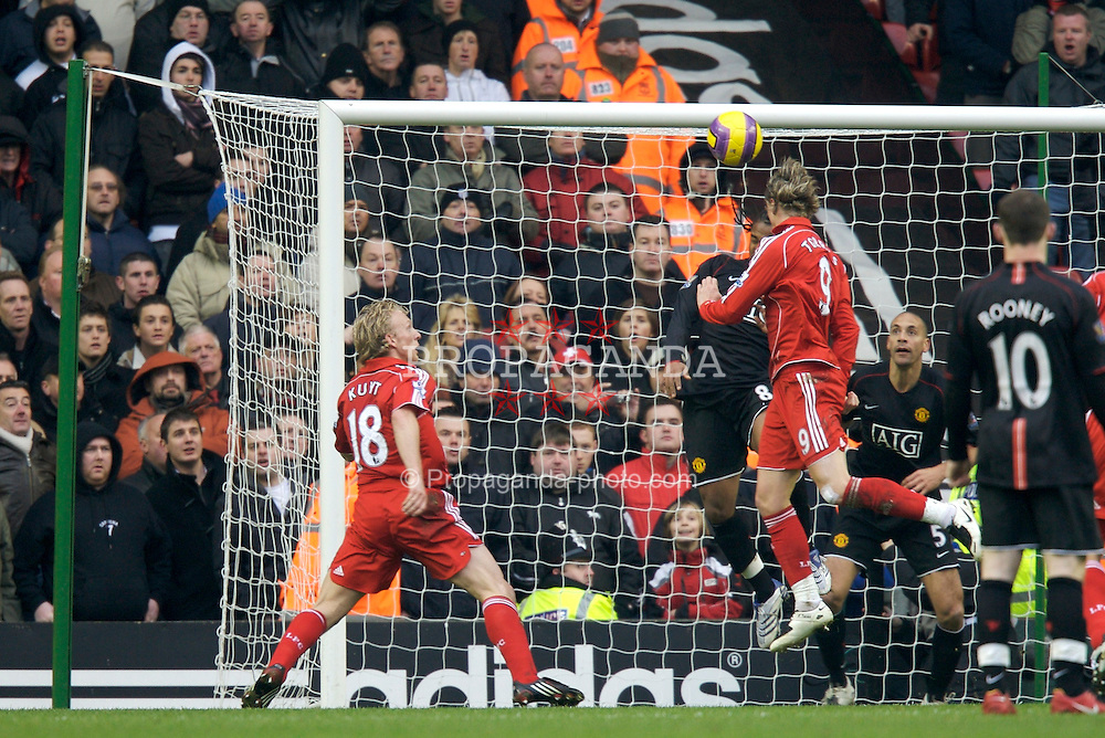 LIVERPOOL, ENGLAND - Sunday, December 16, 2007: Liverpool's Fernando Torres heads wide of the Manchester United goal during the Premiership match at Anfield. (Photo by David Rawcliffe/Propaganda)