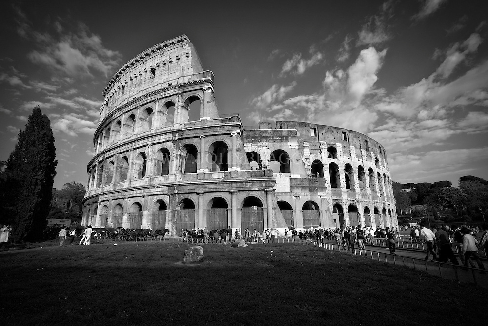 Black and white photo of the colosseum in rome italy