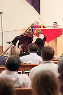 Jubilee members interpret Station Five, where Simon of Cyrene helps Jesus carry the cross, during a performance of 'The Way of the Cross' at St. Luke Catholic Parish in Beavercreek, Friday, March 30, 2012.  'The Way of the Cross' retraces 'the path Jesus walked on his way to Calvary.'